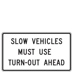 Slow Vehicles Must Use Turn Out Ahead Sign